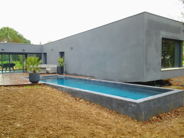 Construction de piscine contemporaine o 39 mineraux for Permis construction piscine