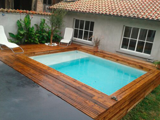 Spa nager ou mini piscines for Mini piscine bois enterree